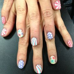 lillianloveslacquer:  Today, I painted a coworker's nails at work. Swirls, dots,  flowers for a baby shower :)
