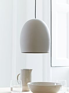Beautifully cast from ceramic in a smooth oval shape, this simply designed pendant has a matte finish that looks like smooth concrete. With a traditional black and white woven flex and matching ceiling rose, this ceramic pendant adds cool contemporary Grey Ceiling, Ceiling Rose, Ceiling Lights, Luxury Lighting, Modern Lighting, Lighting Ideas, Table Lighting, Studio Lighting, Kitchen Lighting