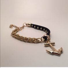 ✨30% off bundles✨Black anchor bracelet New in packaging. Alloy and gold plated. Jewelry Bracelets