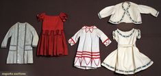 Four little boys' dresses, 1850-1880; 1 red wool with black dots; 3 cotton: 1 black on white calico with red trim; 1 white pique dress and jacket trimmed with white braid and blue ribbons; 1 blue and white stripe chambray