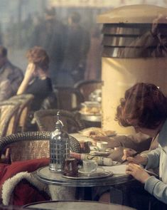 Saul Leiter. In a Parisian Cafe, 1967