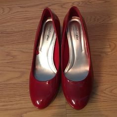 Red Heels VERY COMFORTABLE red shiny heels by Comfort Plus by Predictions, from Payless.  Heel is 3 inches.    Condition: Has black smudge in the back (as pictured) the rest of both shoes are in good condition!! Shoes Heels
