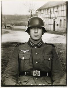 """German photographer August Sander's iconic portrait of a German soldier. Sander once remarked, """"I never made a person look bad. They do that themselves. The portrait is your mirror. It's you."""""""