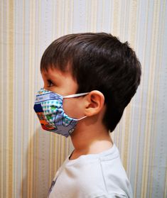 The mask is reusable, two-layer, fits well on the face of the child. By purchasing a template once, you save time and money on a purchase, rather than looking for ready-made masks. This product may be made of fabric or old clothing that you no longer use. Baby Face, Child Face, Diy Mask, Diy Face Mask, Face Masks, Custom Lapel Pins, Mask Template, Mask For Kids, Sewing Hacks