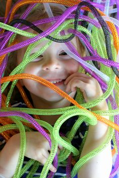 """Have some silly Halloween fun with an all ages mess free Halloween Sensory Bin: slinky, stretchy, scaly Halloween """"Snakes"""". From Fun at Home with Kids Sensory Tubs, Sensory Boxes, Sensory Activities, Infant Activities, Sensory Play, Sensory Diet, Baby Sensory, Halloween Activities For Kids, Halloween Themes"""