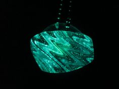 Glow in the dark glass necklace pendant, recycled from a broken pipe, and melted into jewelry, by Eighth Planet Glass
