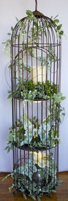 "LADY MADONNA'S (Wedding & Event Planner); Yankton, South Dakota. This is one of our beautiful Bird Cages that we have available for rent. RENTAL PRICE: $8.00. Decorations not included (rented separately). RENTAL PRICE OF BIRD CAGE WITH THESE DECORATIONS: $25.00. BIRD CAGE measures 44"" tall (with 6"" spike) and 11"" wide. Find us on FACEBOOK.COM Please call us at: 605-665-6583 or 605-665-8842, for more information. Thanks! Madonna"