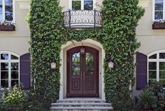 Traditional Front Door with Arched window, exterior stone floors, Glass panel door