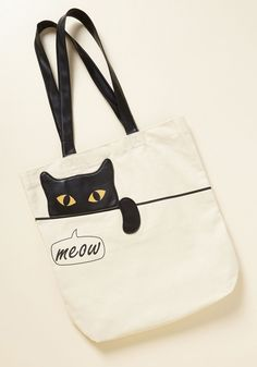 Give You Paws Tote. With all your essentials fit 'purr-fectly' inside this ivory tote bag, you'll stop to smile about your style several times over the course of the day!  #modcloth
