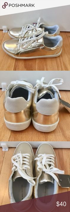 Gold metallic laminated plimsolls. Stylish casual shoes in soft metallic gold with white lace up. Great with your casual outfits and fun dresses. Excellent condition! Tried the shoes on to walk around to see how they fit. I will dust off the bottom so they will be nice and white when sold. Zara Shoes Sneakers