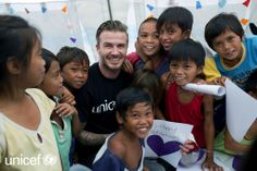 David Beckham charity: David Beckham poses for a photo with children in The Philippines. David Beckham and UNICEF have launched The David Beckham UNICEF Fund David Beckham Unicef, Philippines Cities, Football Icon, Star Track, Helping Children, Children Play, Celebs, Celebrities, Worlds Of Fun