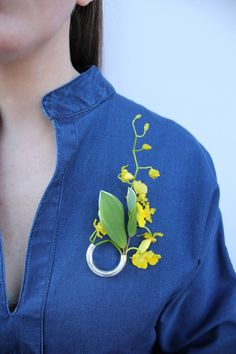 From the brand new Botanical Composition series! The sleek Gold Lady Grey brooch comes filled with assorted silk flowers (not pictured) that can be replaced with fresh flowers or greens of your choice