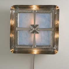 Silver Cross Sconce from Chequer's in Aspen, Co.