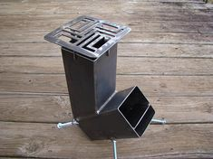 Brand new, self-feeding (gravity feed) rocket stove with the NEW, upgraded cooking grate! All stoves purchased from January 23, 2018 and forward will include the new cooking grate. The grate can be purchased separately if you own a previous version of my rocket stoves and would like to