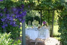 Lovely this outdoor space with blue clematis! I would like clematis for the latice fence in the back yard.