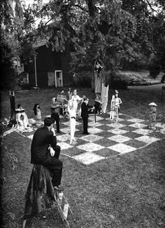 by Philippe Halsman, French-American artist Marcel Duchamp directs a life-size chess game, Connecticut, 1956