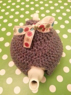 Blue crochet tea cosy and buttons