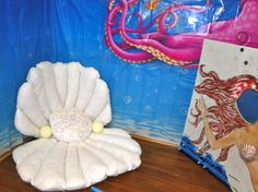 Whats a mermaid diva without a pearl oyster shell chair to lounge around under water in??? Felt, quilt batting and glitter fabric glue.  Pearls are styrofoam balls...