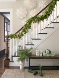 Instead of a single-note pine decorating the staircase of this Connecticut farmhouse, the owners opted for an intricate FiftyFlowers garland that incorporates fresh asparagus ferns and evergreen shrubs.