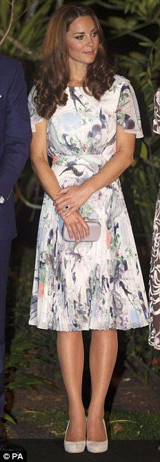 ERDEM: In the evening, she changed into this flower print dress carrying a lilac box clutch