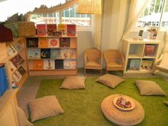 I like the large space this reading area has. I also like how chairs and pillows are providing for seating in the area, along with three shelves for books. Classroom Layout, Classroom Design, Future Classroom, Classroom Decor, Play Spaces, Learning Spaces, Learning Centers, Preschool Reading Area, Preschool Rooms