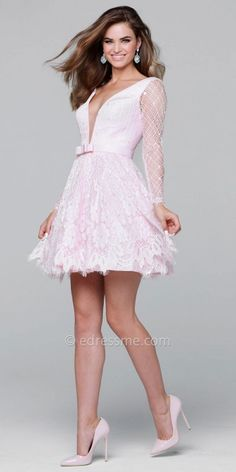 Define elegance in this Long Sleeve Floral Lace Fit and Flare Cocktail Dress by Tarik Ediz Prom. This style features a plunging V-shape neckline with an illusion panel. This style includes a classic fit and flare silhouette with a lace overlay and sheer long sleeves. #edressme