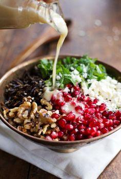 Pomegranate, kale, wild rice, walnuts, feta, honey, & lemon (I'm using black rice not wild rice)