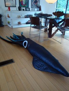 I made this for my daughter.  Here's a link to the pattern I loosely used.  http://blogs.philadelphiaweekly.com/style/2009/02/12/fridiy-8-foot-giant-squid-pillow/