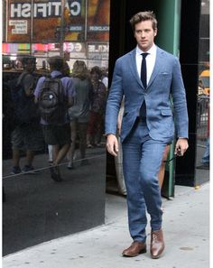 """GQ: The Week in Style: 6.28.13 - Armie Hammer in NYC  """"Now this guy, in this blue suit: Armie looks like he's about to buy your girlfriend a drink and give his business card to your boss. It's amazing."""""""