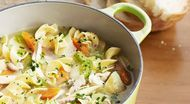 To make this comforting soup, we start by fortifying store-bought chicken broth with a bunch of fresh vegetables.