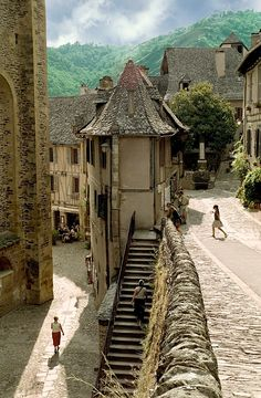Village of Conques – Midi-Pyrenees, France. Straight out of Tolkien, enjoy the cobbled streets and breathtaking views of this mountainside village in France. Places To Travel, Places To See, Travel Destinations, Travel Stuff, Places Around The World, Around The Worlds, Wonderful Places, Beautiful Places, Beautiful Buildings