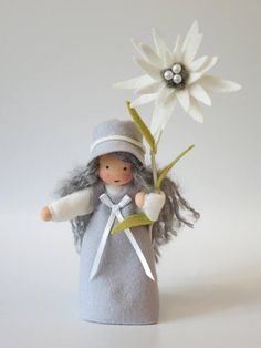 The little Edelweiss is made of 100 % wool-felt, fairy tale-wool and tricot material. centimeters high The filling is sheepwool Not suitable for the under Your doll will be unique! Made to order Feel free to ask me :o) Christmas Figurines, Xmas Ornaments, Barbie, Felt Crafts, Fabric Crafts, Felt Fairy, Nature Table, Felt Patterns, Flower Fairies