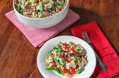 Pasta salad with cherry tomatoes, sweet corn, fresh basil, bacon, and feta cheese.