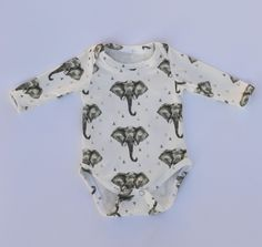 this elephant print is uniquely designed exclusively for Our Little Lullaby , and made with the softest fabric for your little one's delicate and sensitive skin.these onesies are 100% USA grown GOTS certified organic cotton, the highest quality organic material with no harmful chemicals. please note that all your onesies are handmade and unique, therefore pattern placements may vary slightly from the onesies pictured.machine wash warm or cool, gentle/delicate cycle, to p...