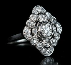 A Vintage Art Deco Diamond Platinum Engagement Ring 1920s, probably French, marked with lozenge-shaped maker's mark An openwork platinum ring is set with t