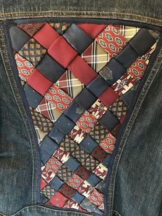 Upcycled Re-Fashioned Denim Jacket with hand woven silk ties inset in back and on collar! I pre-wash all my upcycled jackets before I embellish them.....this jacket should be dry cleaned as the ties are made of silk....I handwove them and inserted them on the back and appliqued some