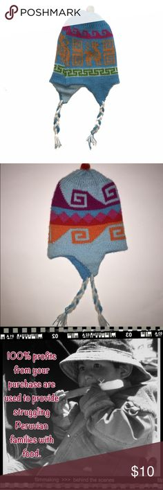 HANDMADE PERUVIAN HATS-2T HANDMADE hat all the way from Peru! Size is about a 2T. Reversible (see pic for other side).  NWOT. All profits from sale of this item are donated to feed hungry Peruvian families.  *ask me to bundle your likes and save!  Tag: baby, toddler, knit, handcrafted Accessories Hats