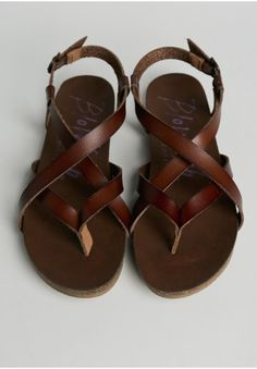 pair of summer-ready Ruche sandals. (Granola Strappy Sandals By Blowfish)