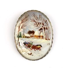 """""""Russian Winter Sleigh Pin Item No. BP00137A01 $51.09 This luminescent Winter scene pin features a horse-drawn sleigh in a classic Russian village. It was expertly painted on an oval shaped mother-of-pearl gemstone that is nested into a German silver frame that contains a pin on the back. Each brooch is painted in the classical Fedoskino style. Fedoskino is the famous Russian school of miniature painting. Initialed by the artist on the front."""" Russian Landscape, Russian Jewelry, Russian Winter, Magical Christmas, Pearl Gemstone, Viking Jewelry, Christmas Jewelry, Winter Scenes, Hand Blown Glass"""