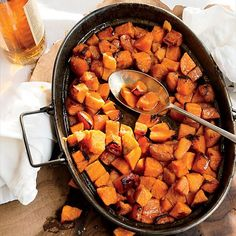 Candied Sweet Potatoes with Bourbon | At Thanksgiving, these are the sweet potatoes you'll find at Anthony Bourdain's table. Get the recipe from Food & Wine.