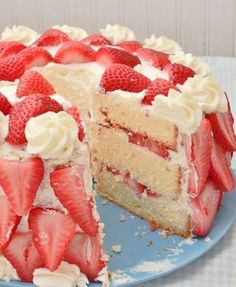 Heavenly Strawberries n Cream Cake recipe. Not only does this cake look amazing, it tastes just as delicious. With fresh strawberries, homemade whipped cream, and a pound-cake-type texture, Strawberries n Cream Cake is the perfect strawberry dessert.