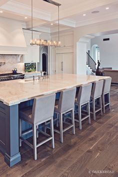 """Live Sawn Hardwood Flooring- Kitchen with Live sawn Hardwood Floors-Live sawn floors are cut straight through the log, producing wavy """"cathedrals"""" along the center of the board and straighter grain on the edges #LivesawnHardwood #LivesawnHardwoodFloor Oak & Broad"""