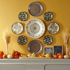 We created this pretty dish display with inexpensive melamine plates from Target and adhesive disc hangers.  Details: http://www.midwestliving.com/homes/seasonal-decorating/fall-decorating-1-mantel-3-ways/?page=6