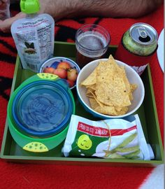 Part of a very un-fancy front yard picnic, featuring toddler food, beer, cherries, and chips.