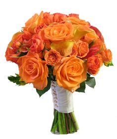 Bridal bouquet for wedding & reception at the Trolley Barn.  'Voodoo' roses, orange spray roses, ranunculus, 'Mango' calla lilies, orange 'lily' tulips...