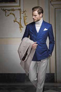 Blue double breasted blazer, beige trousers, white turtleneck