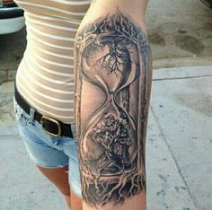 Grey Ink Realistic Tree In Hourglass Tattoo On Left Forearm