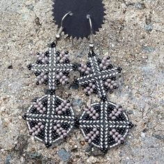 Handmade circular herringbone stitch earrings in a black and silver palette. j_valiente's photo on Instagram