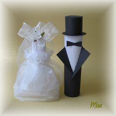 Ženich+a+nevěsta+Postavičky+vyrobené+z+vlnitého+a+hladkého+kartonu+,nevěsta+ozdobena+smetanovou+organzou+,stuhou+a+kytičkama.+výška+postaviček+24cm+a+20cm+vhodné+jako+ozdoba+na+svatební+dar+nebo+na+svatební+stůl+před+nevěstu+a+ženicha+jako+jmenovky.+Pokud+by+měl+někdo+zájem,+bylo+by+možné+vyrobit+tyto+postavičky+ve+větším+rozměru+jako+návleky+na+lahve.