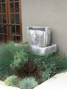 debora carl landscape design.  A beautifully designed water feature for an arid environment. Any spillover will be soaked up by the garden.